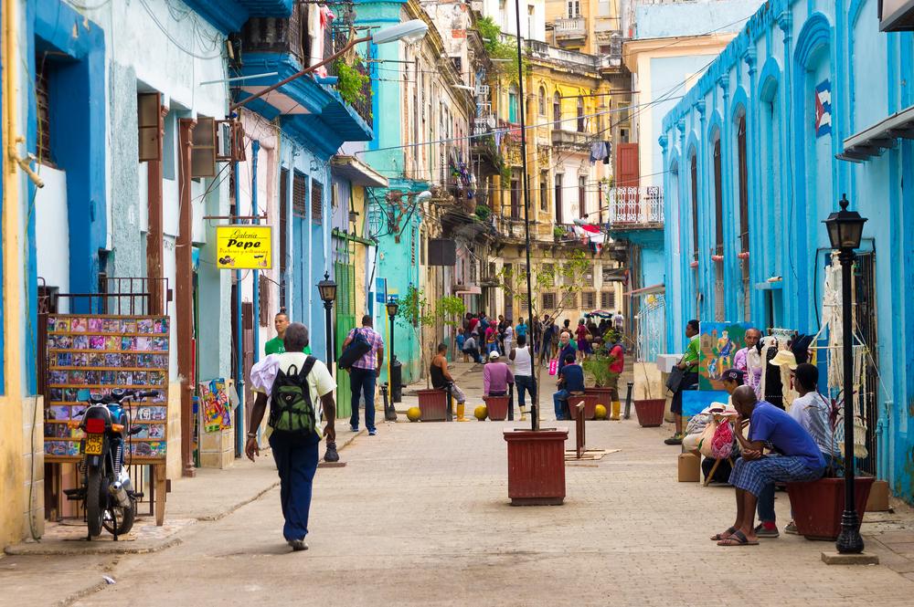 HAVANA DECEMBER 14 Street scene with cuban people and colorful old buildings December 142012 in Havana
