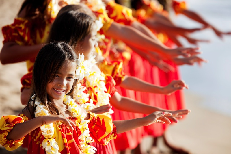 Hula girls on the beach with Hands raised
