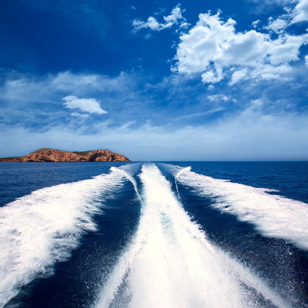 Ibiza Sa Conillera island from boat wake way to San Antonio at Balearic Islands
