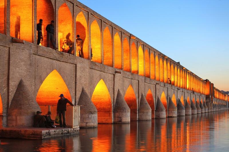 Khajoo bridge over Zayandeh river at dusk with lights Isfahan Iran