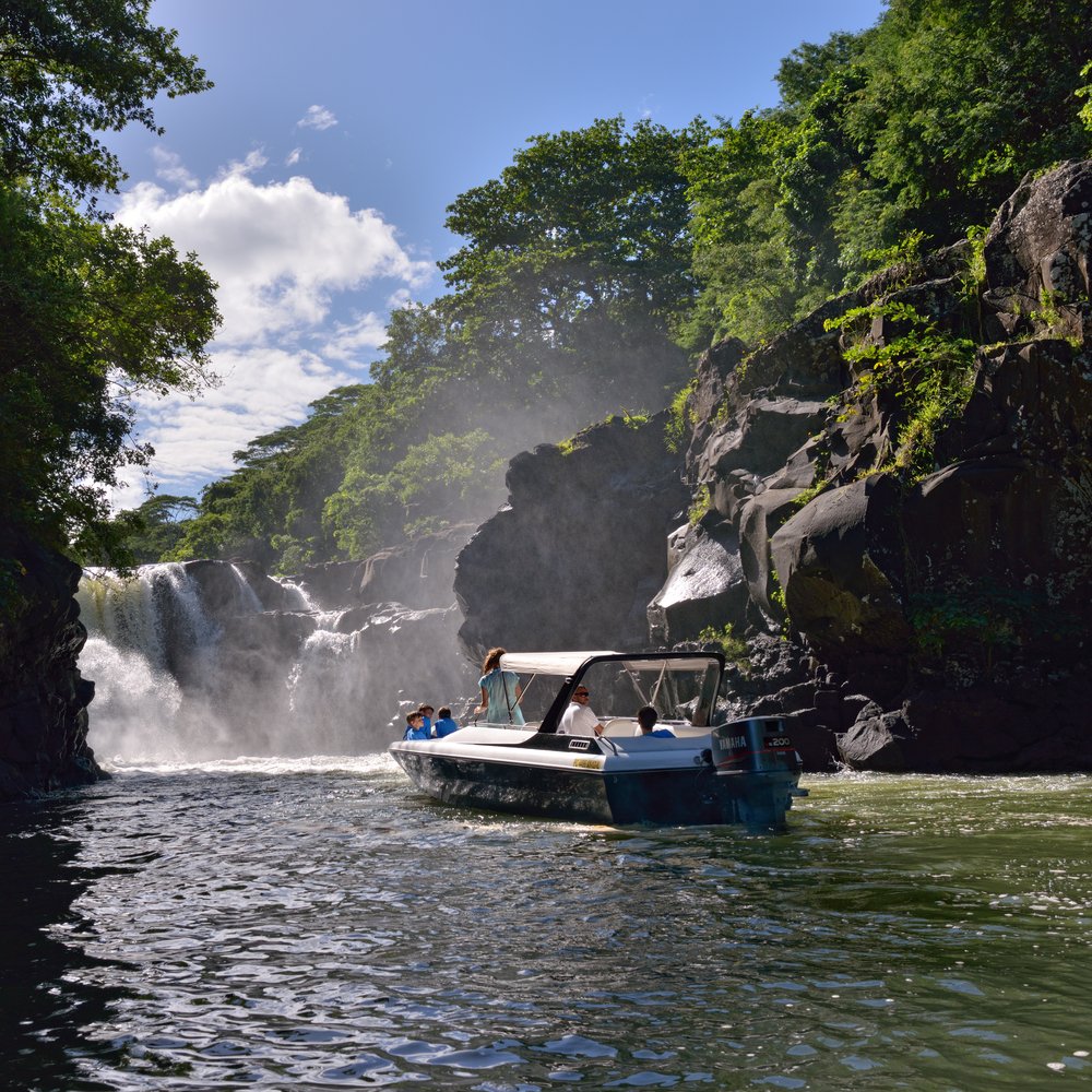 MAURITIUS MAY 1 Tourists watch the Grand River waterfall from boat on Mai 01 2013 at Mauritius