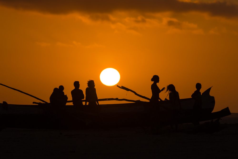 MORONDAVA MADAGASCAR OCT 29 Sunset on a canoe and unidentified Malagasy people on oct