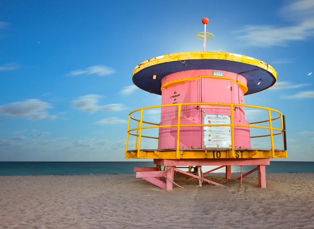 Miami Beach Florida colorful lifeguard house in typical Art Deco architectural style long night exposure under moonlight