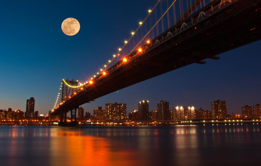 Moon rises over Manhattan Bridge