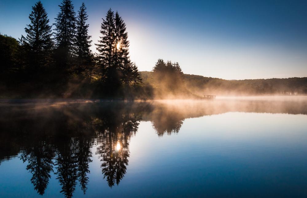 Morning fog on Spruce Knob Lake after sunrise Monongahela National Forest West Virginia