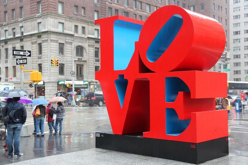 NEW YORK JUNE 7 People walk past Love sculpture in rain on June 7 2013 in New York