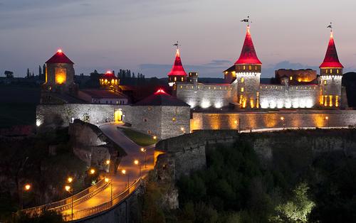 Night panoramic view of medieval half ruined castle in Kamenetz Podolsk Ukraine