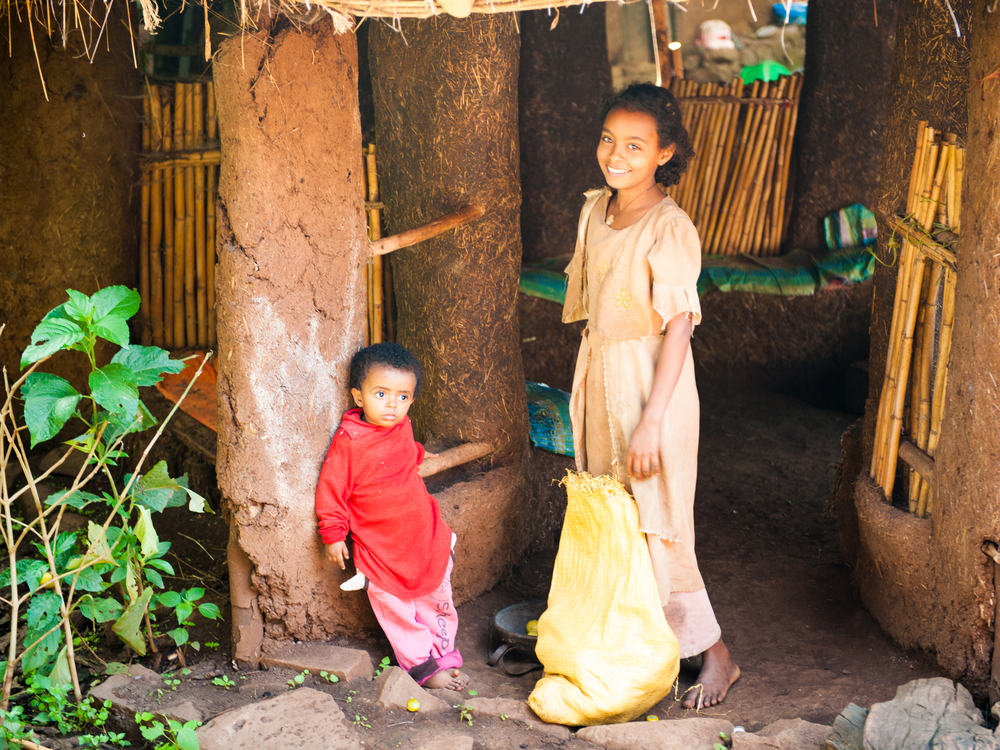 OMO ETHIOPIA SEPTEMBER 19 2011 Unidentified Ethiopian little beautiful girl and boy stay near the