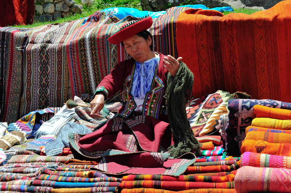 PISAC PERU SOUTH AMERICA MARCH 07 Woman is presenting her souvenirs on sunday market in Pisac on March 07 2010 in Pisac peru south america