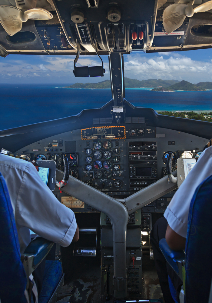 PRASLIN MAY 21 Air Seychelles pilots in the plane cockpit over tropical island on May 21 2012 in Seychelles