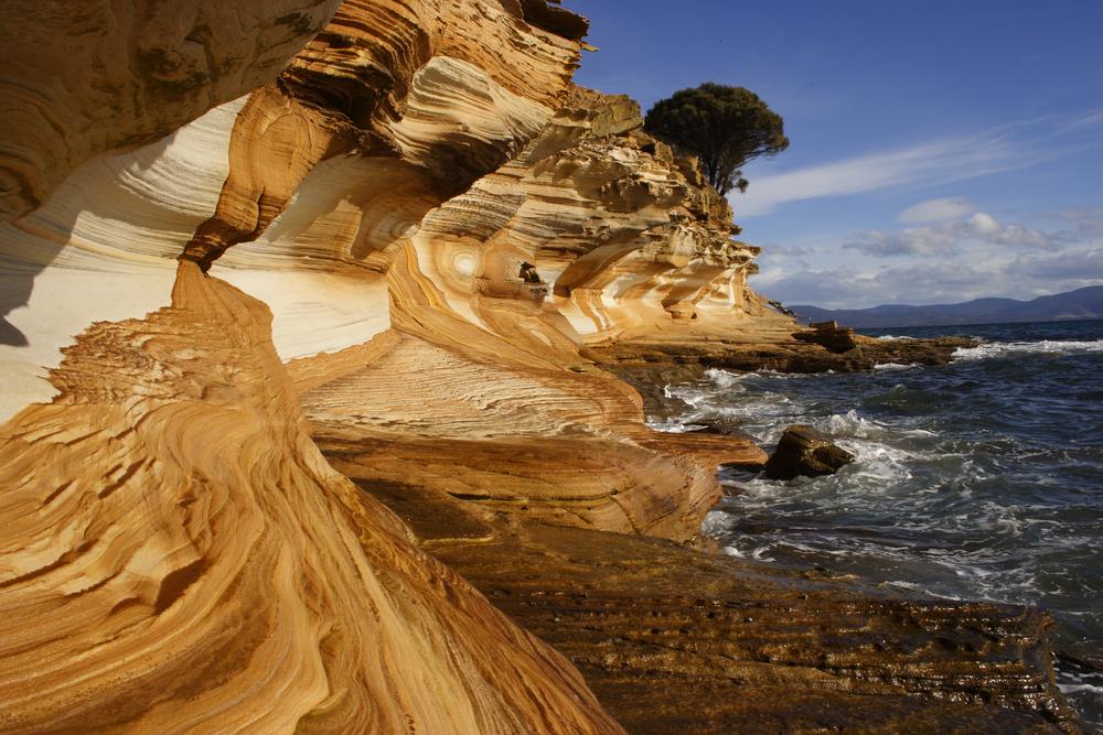 Painted cliff formation on Maria island off the eastern coast of Tasmania Australia