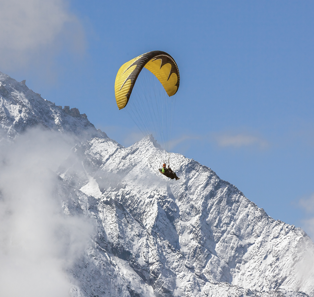 Paraglider flying against the mountain Lhotse 8516 m Everest region Nepal Himalayas