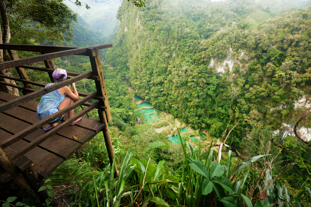 Photographer on the lookout point on the Cascades National Park in Guatemala Semuc Champey 4