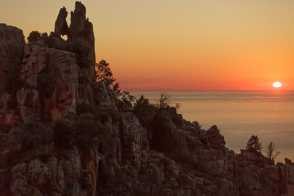 Piana rocky coastline at sunset Corsica island France