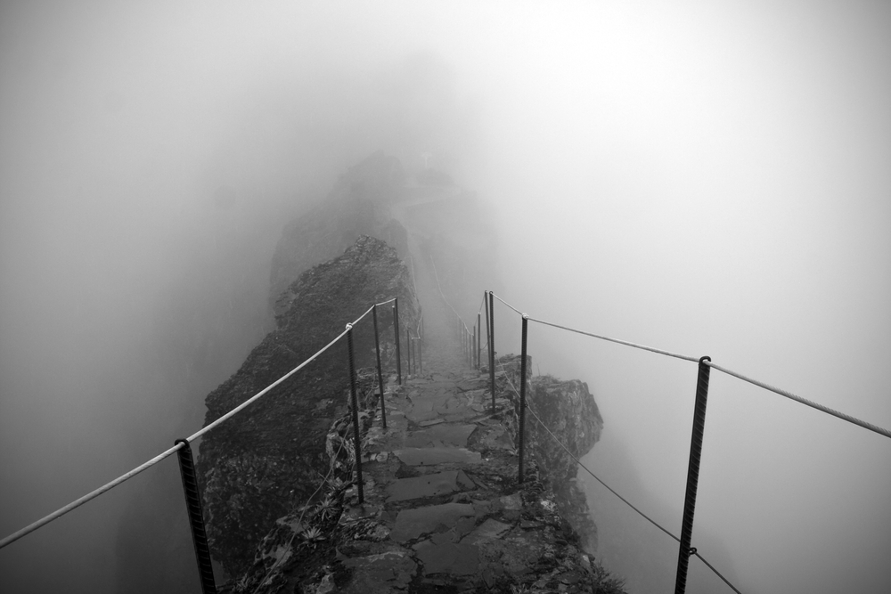 Pico Ruivo and Pico do Areeiro mountain peaks in a fog in Madeira Portugal