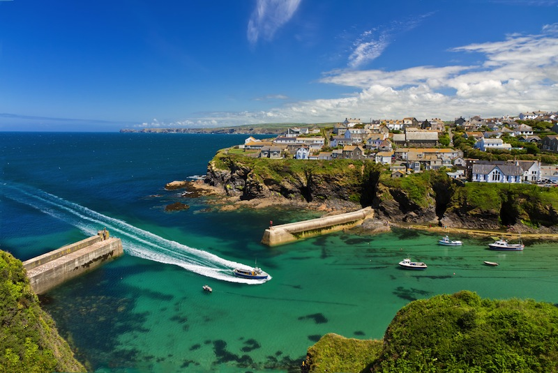 Port Isaac with arriving ship Cornwall England