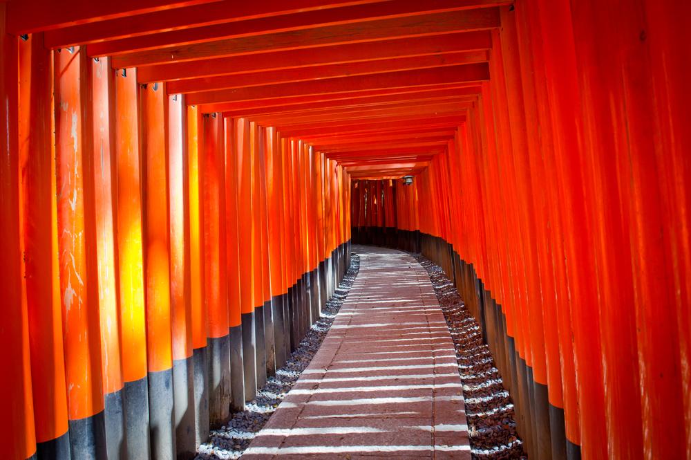 Red Tori Gate at Fushimi Inari Shrine in Kyoto Japan