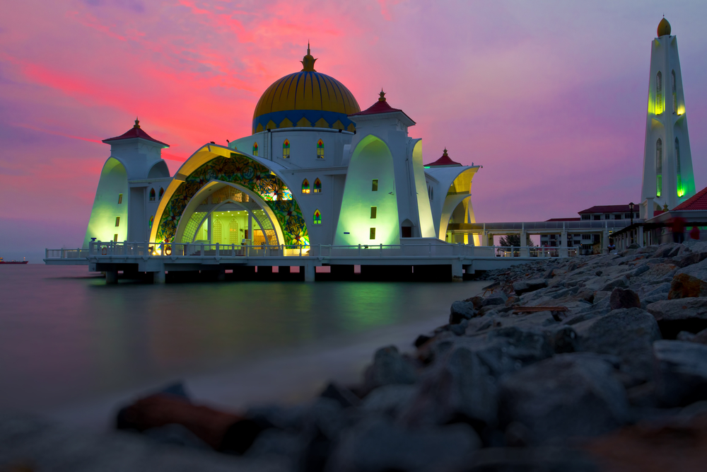 Reflections of famous floating mosque on water of sea in Malacca Malaysia Asia