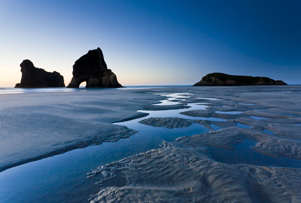Rippled Sand and rock formations at Wharariki Beach Nelson North Island New Zealand