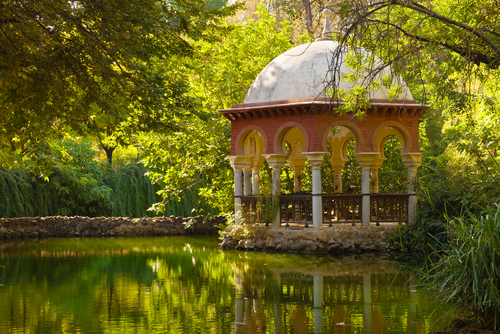 Romantic pavilion reflected in a pond