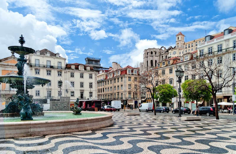 Rossio square with fountain located at Baixa district in Lisbon Portugal jpg