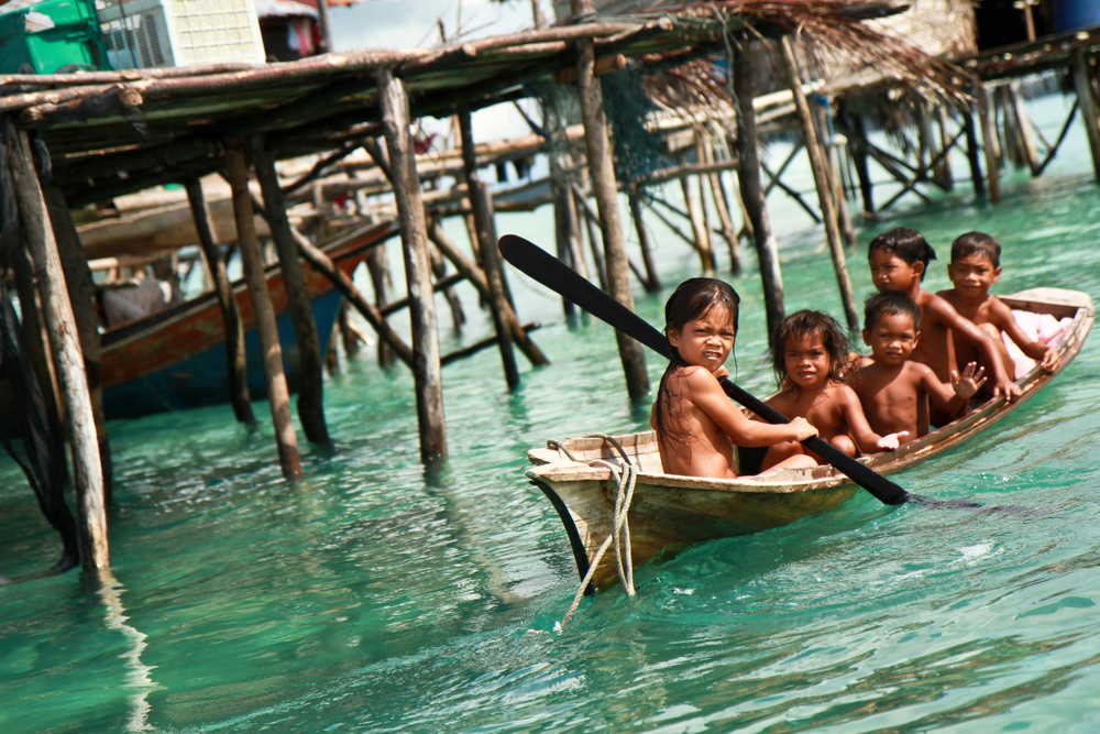 SEMPORNA MALAYSIA MAY 5 Unidentified Sea Bajaus children rowing a boat May 5th 2011 in Sabah Malaysia