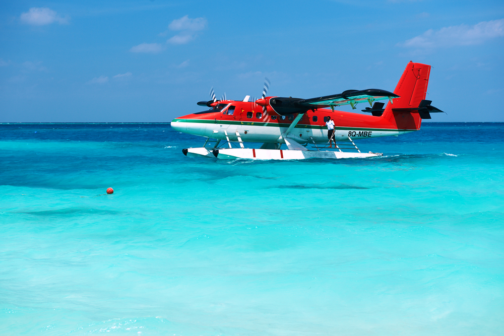 SOUTH ARI ATOLL MALDIVES DECEMBER 12 2013 Twin otter red seaplane at Maldives
