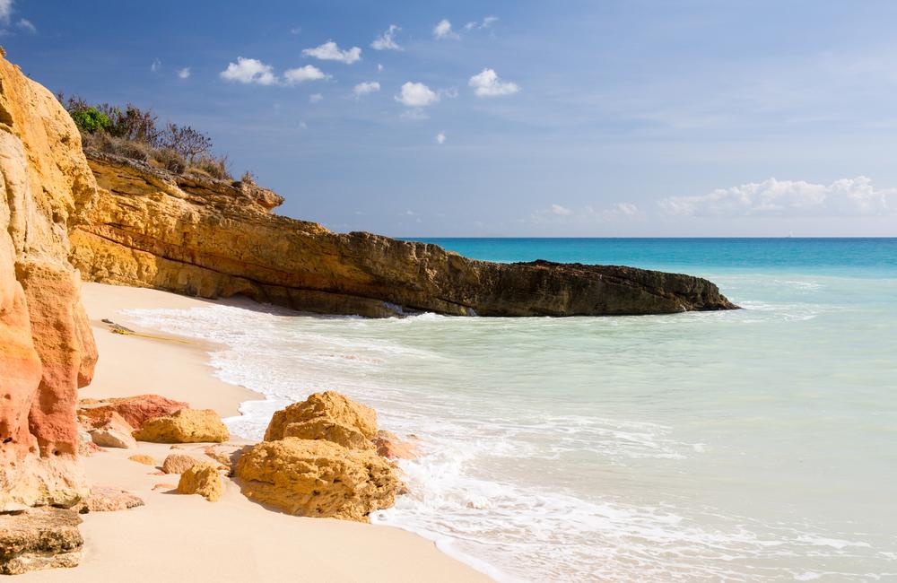 Sandstone cliffs frame Cupecoy Beach on Sint Maarten St Martin Caribbean