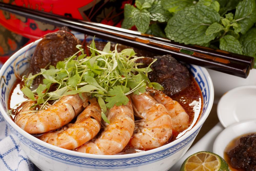 Sarawak Laksa Garnished with Coriander Sprigs