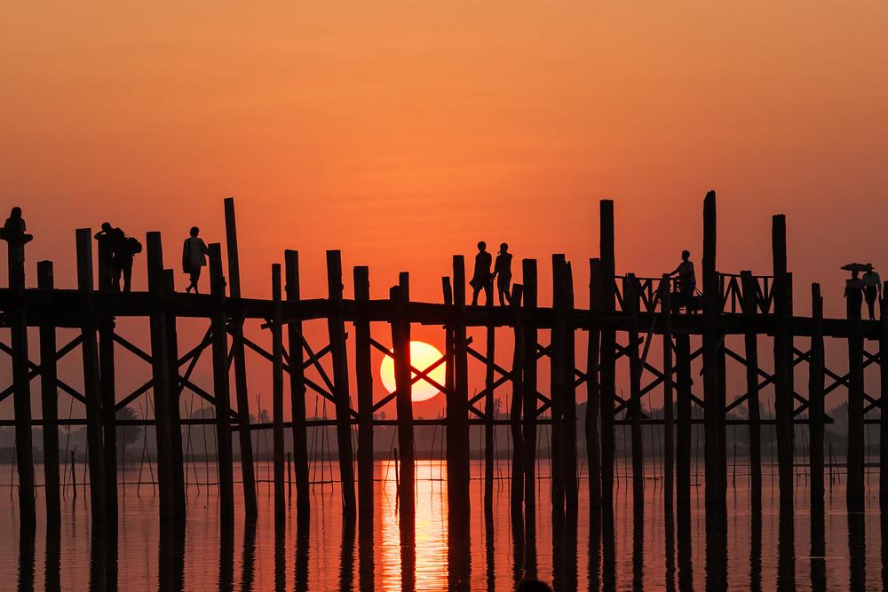 Silhouette of U bein bridge at sunset Amarapura Mandalay Myanmar