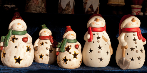 Snowman ornaments at traditional Christmas Market Weihnachtsmarkt in the city of Salzburg Austria