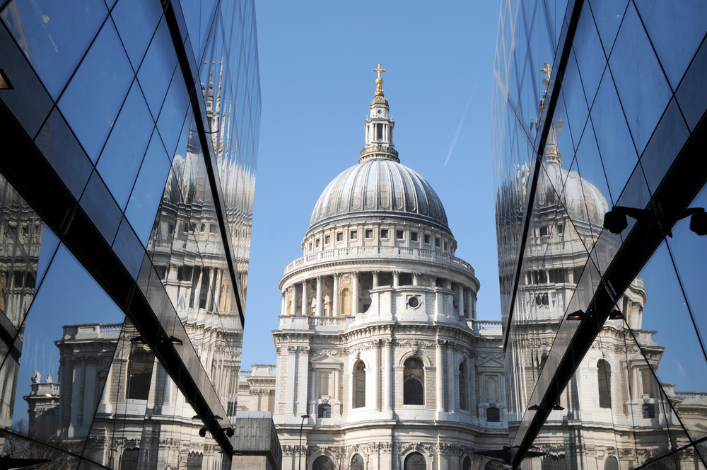 St Pauls Cathedral reflected in glass walls of One New Change in