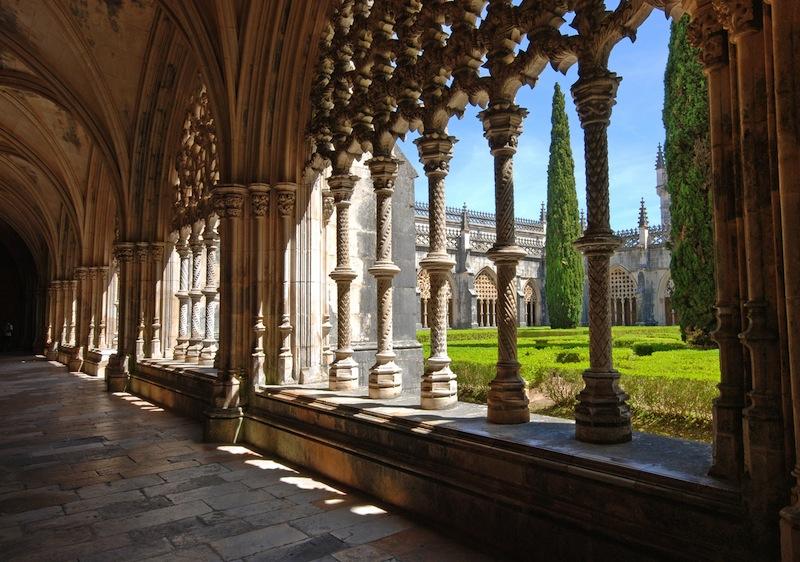 Stone cloister in manuelino style and beautiful garden Batalha