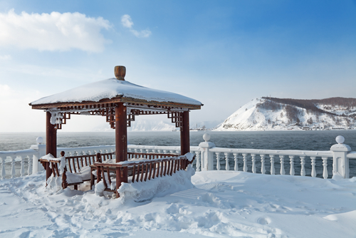 Summer arbour on the shore of lake Baikal at the source of the river Angara a winter landscape Siberia Russia