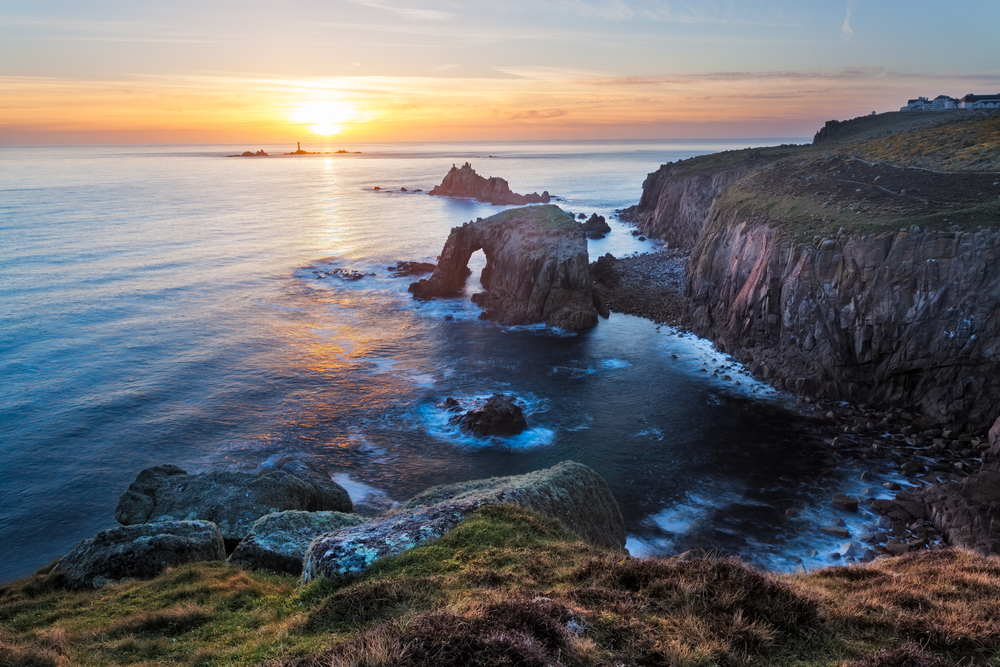 Sunset at Lands End Cornwall England UK showing the rock formations of Enys Dodman and the Armed Knight cornovaglia