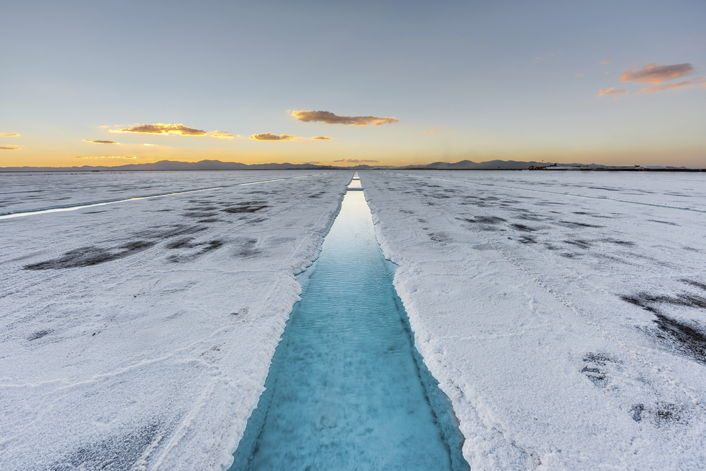 Sunset in Salinas Grandes salt flats water pool in Jujuy province northern Argentina