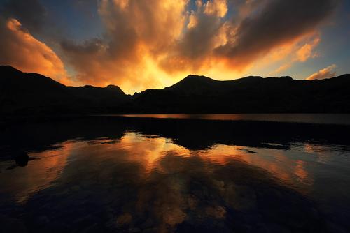 Sunset light over Bucura Lake National Park Retezat Romania