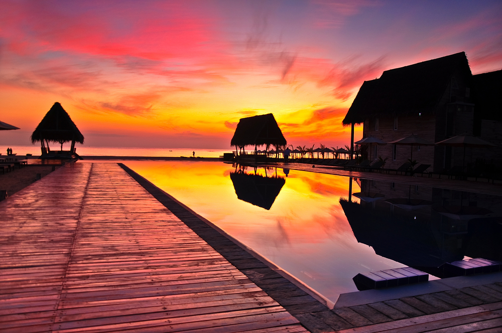 Sunset over ocean and swimming pool in beach hotel sri lanka7