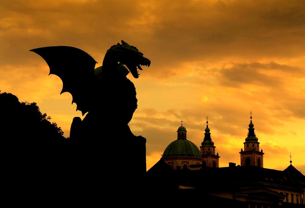 Sunset scene of Green Dragon on the Dragon Bridge in capital city Ljubljana Slovenia