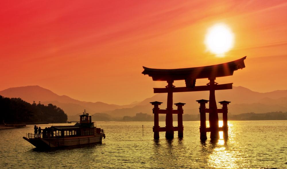 Sunset view of Torii gate Miyajima Japan