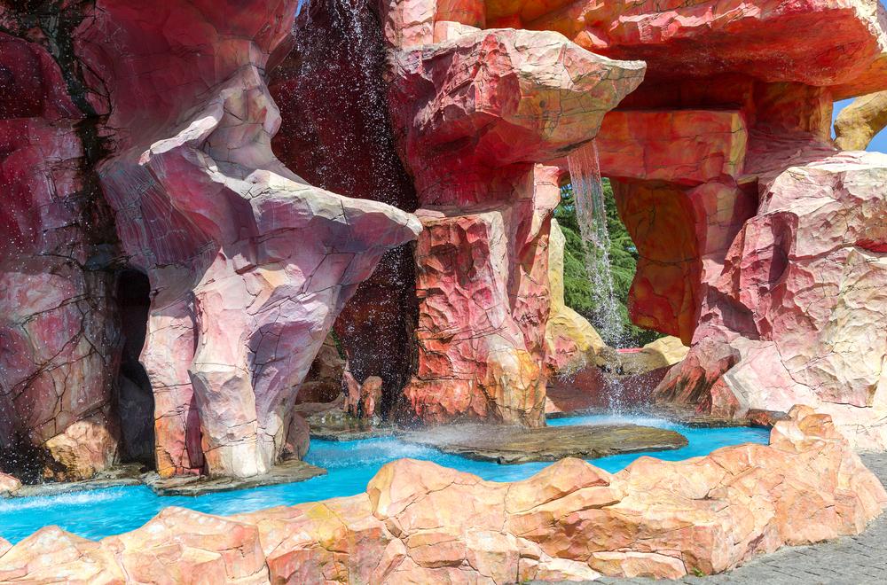 TBILISI GEORGIA JULY 03 2013 Waterfall and unusual red rock in the amusement park Mtatsmindaqu ot