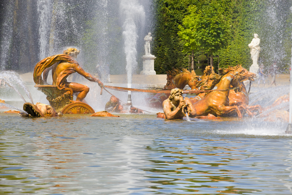 The Apollo fountain spraying water in Versailles Chateau