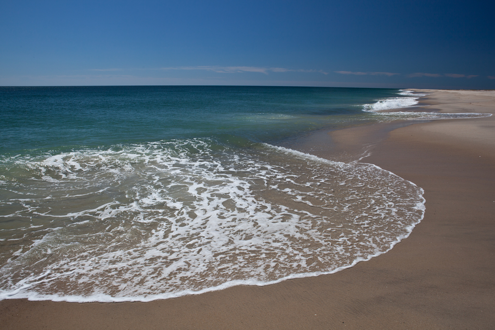 The cold north Atlantic ocean erodes the sand from the Cape Cod National Seashore in Massachusetts