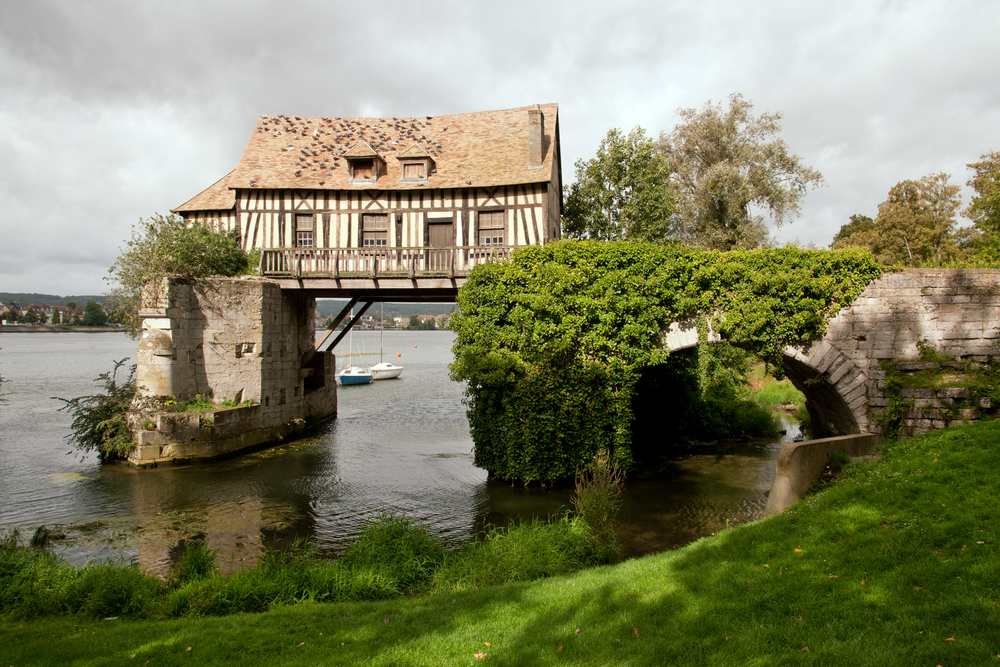 The old mill on medieval bridge in Vernon Normandy