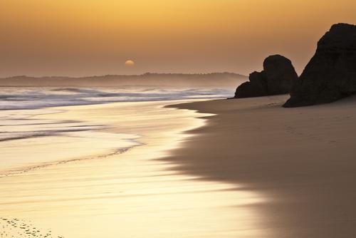 The sun setting over the beach at Alvor