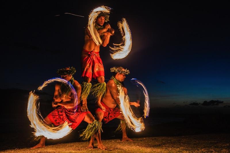 Three Strong Men Juggling Fire in Hawaii Fire Dancers
