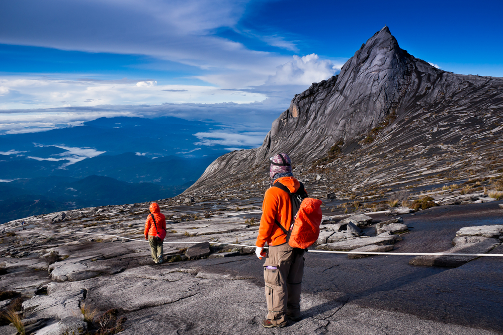 Tourists hinking down Kinabalu mountain in Kinabalu national park