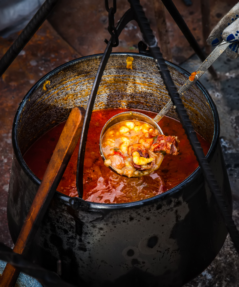 Traditional appetizing and tasty hungarian goulash soup in cauldron