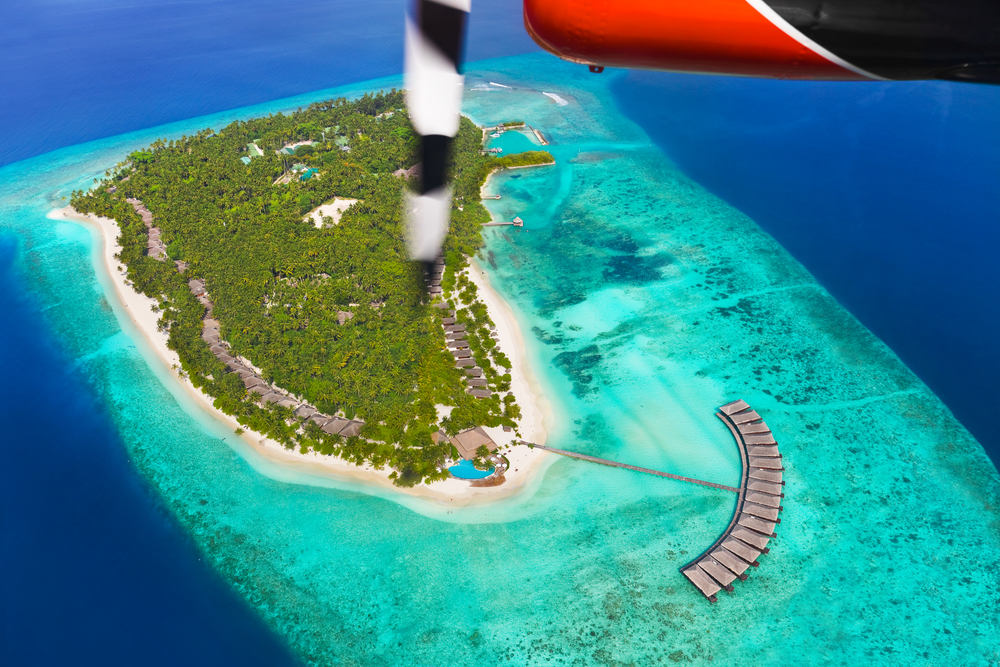 Tropical island at Maldives aerial view
