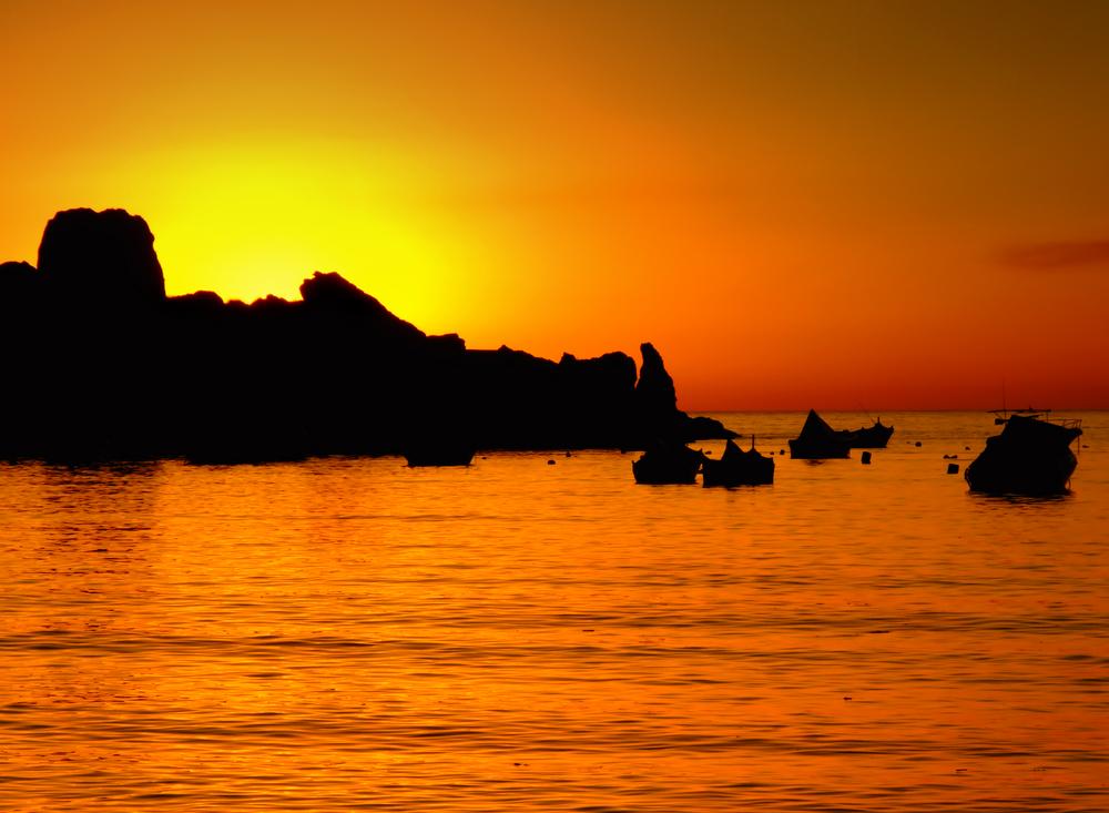 Typical Mediterranean sunset in a tranquil beach in Malta